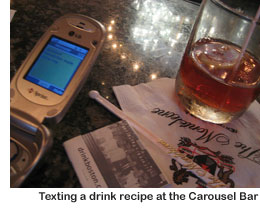Texting at the Carousel Bar