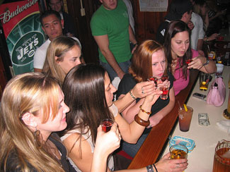 Girls drinking at a bar