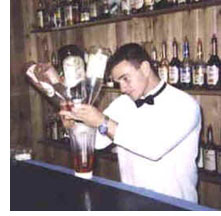 Bartender pouring many bottles
